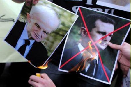 احراق صورة بشار وحافظ