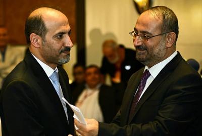 رئيس الحكومة أحمد طعمة ورئيس الائتلاف أحمد الجربا